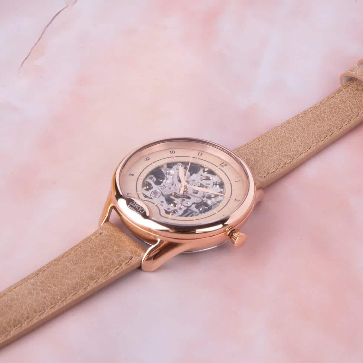 Montre squelette femme rosegold Odyssey avec bracelet cuir grainé beige